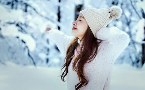 Adobe Stock 249493769 Young Asian woman enjoying the snow, Sapporo, Hokkaido, Japan